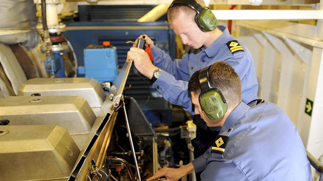 A Royal Fleet Auxiliary Marine Engineer Officer Cadet at work.