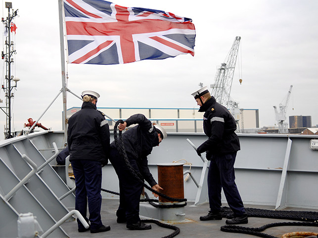 Royal Navy personnel at work at sea.
