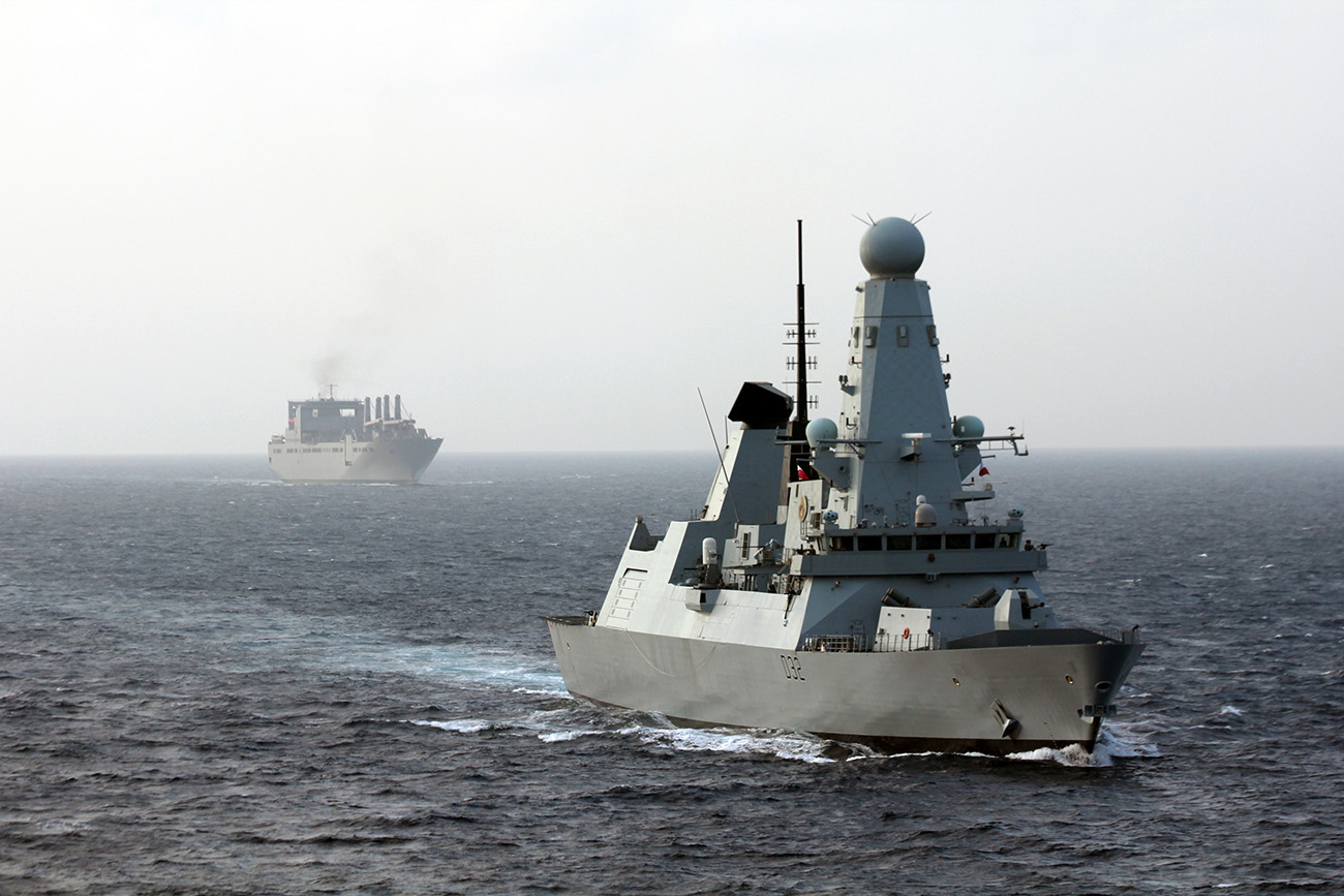 HMS Daring escorts the 62,000-tonne American military ferry/cargo ship USNS Brittin safely through 'missile alley'