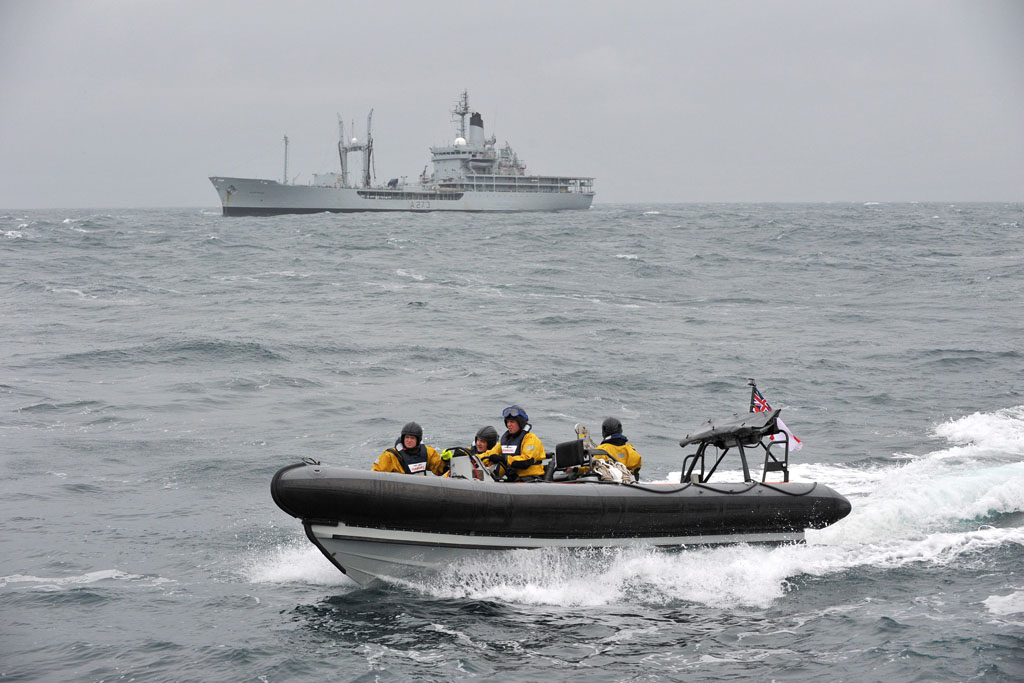 HMS Protector's seaboat with RFA Black Rover