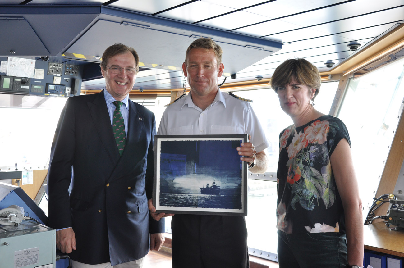 Artist in resident presents painting to HMS Protector
