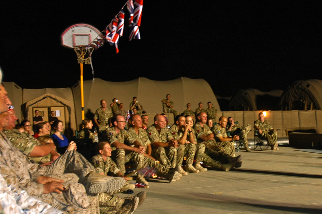 British and US troops watch on as the Band performs