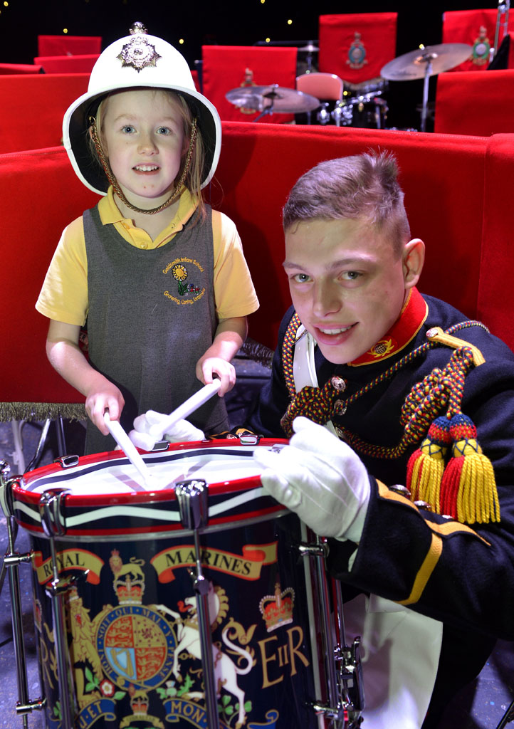 Military musicians raise the roof with School children