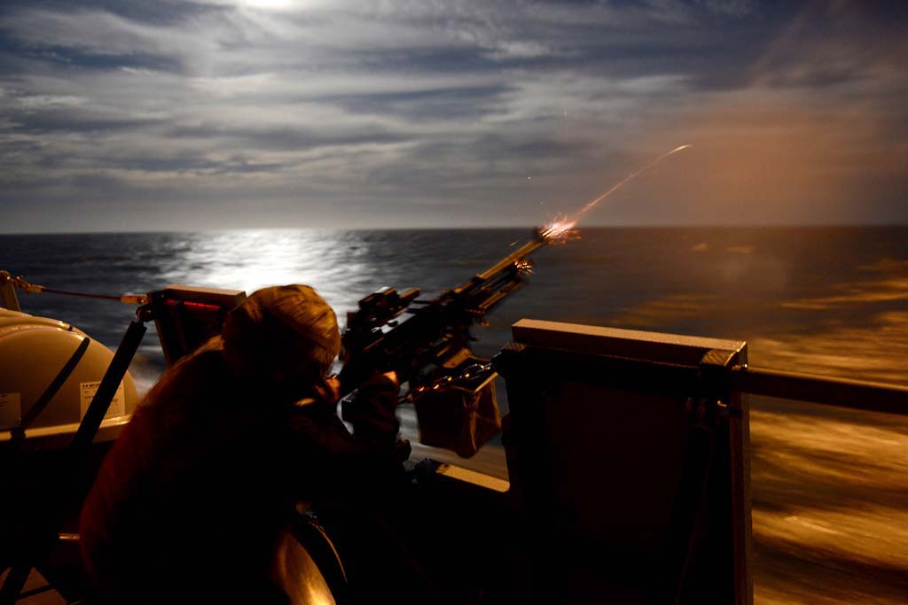 HMS Dragon fires her guns