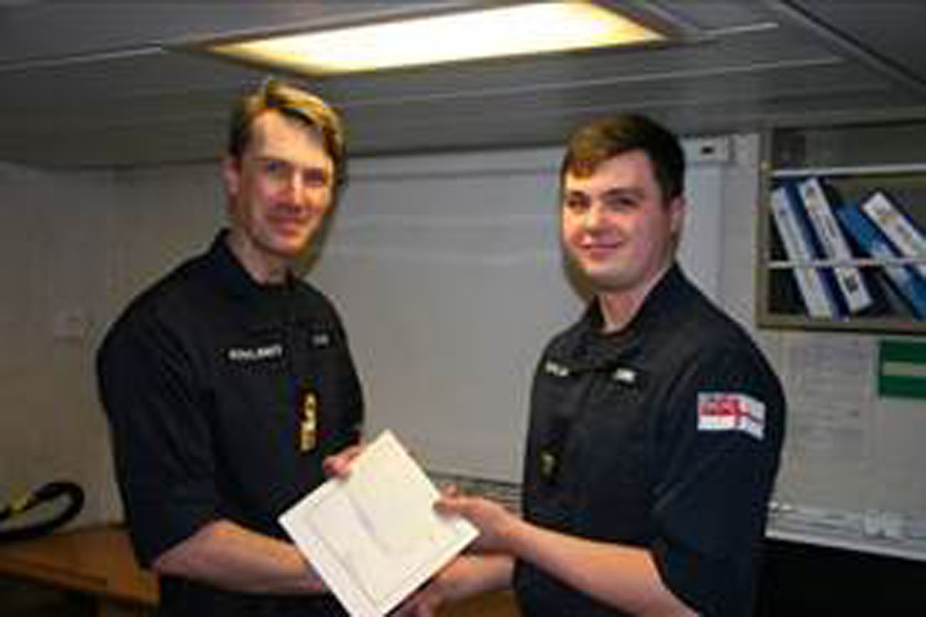 Commodore presents awards to sailors of HMS Tyne
