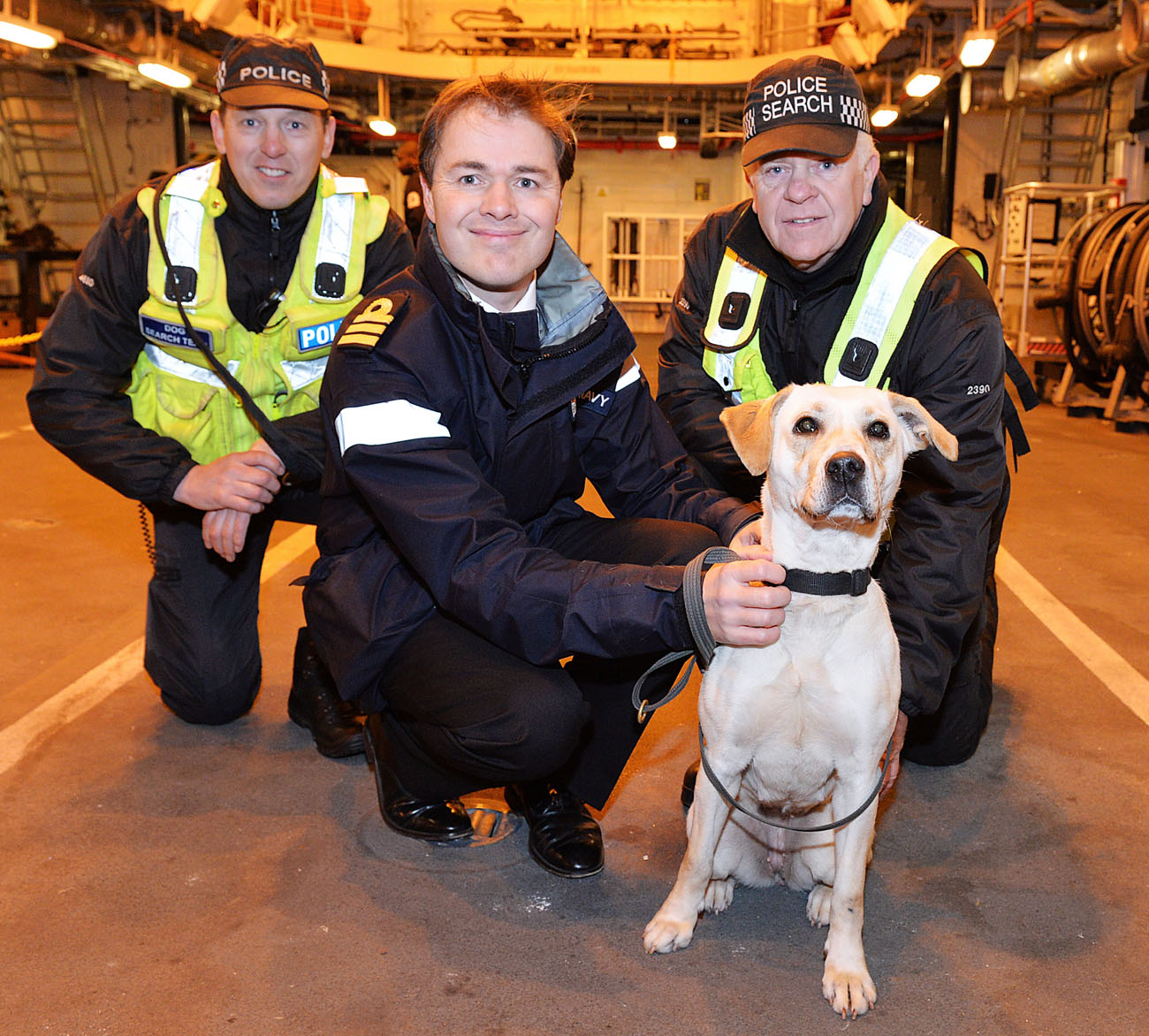 Drugs dogs practice following their nose on board warship